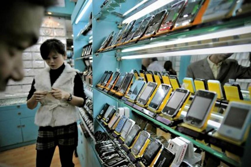 Fake iPhones displayed in a shop at a market known for counterfeit US goods in Shanghai.