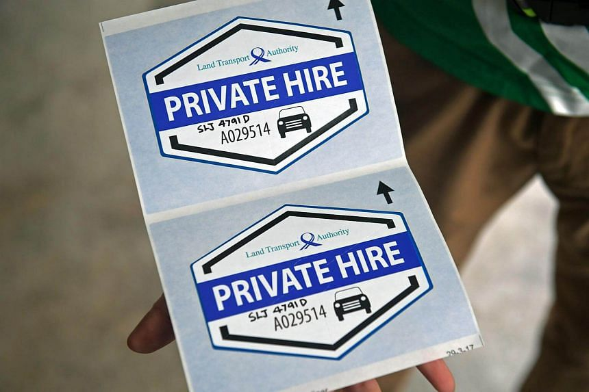 The decals used by Grab to indicate the private-hire car driver has applied for their Vocational Licence.