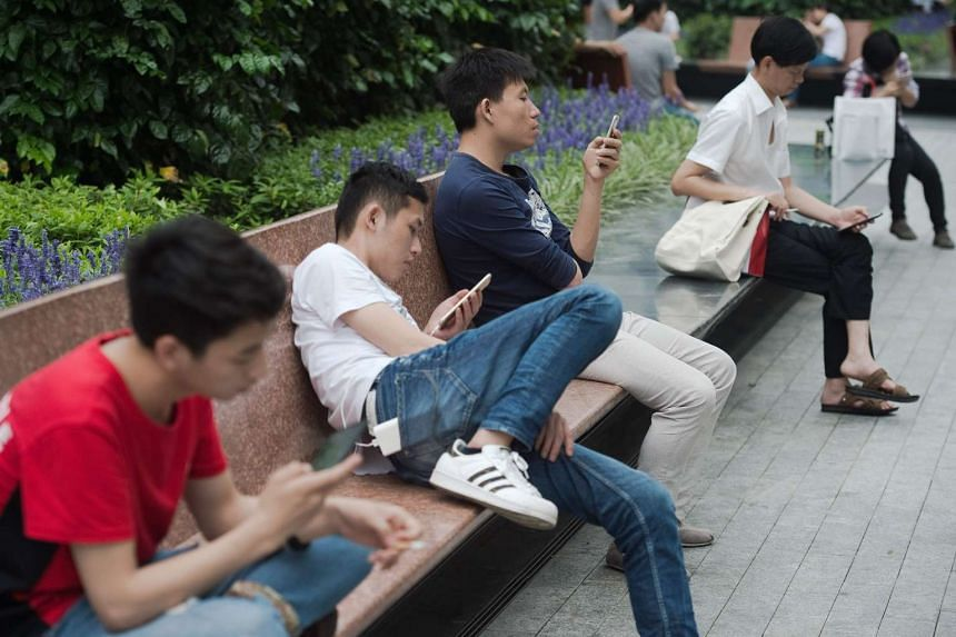 People using smartphones in Shenzhen on May 9, 2017.