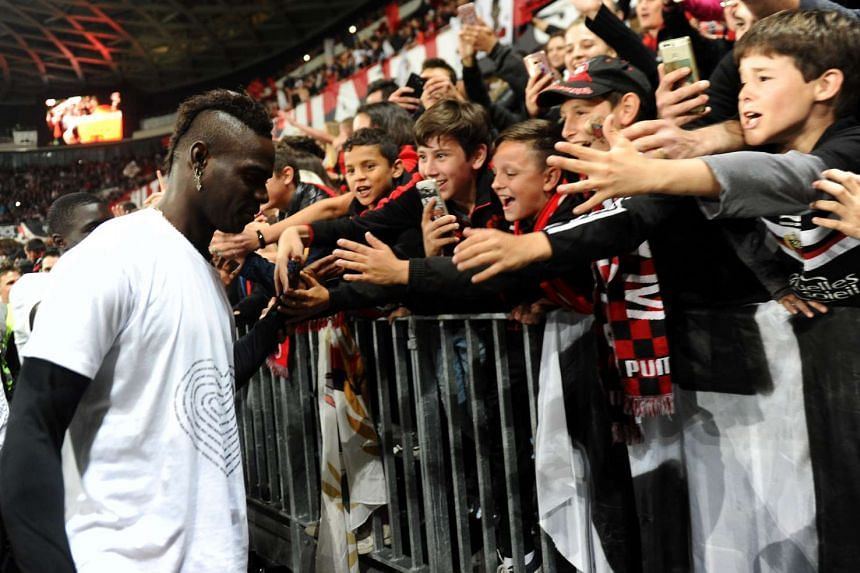 Nice's Italian forward Mario Balotelli thanking supporters after the 0-2 loss to Angers in their football match on May 14, 2017, at the Allianz Riviera stadium. The unfancied French Riviera team finished third in Ligue 1 last season.
