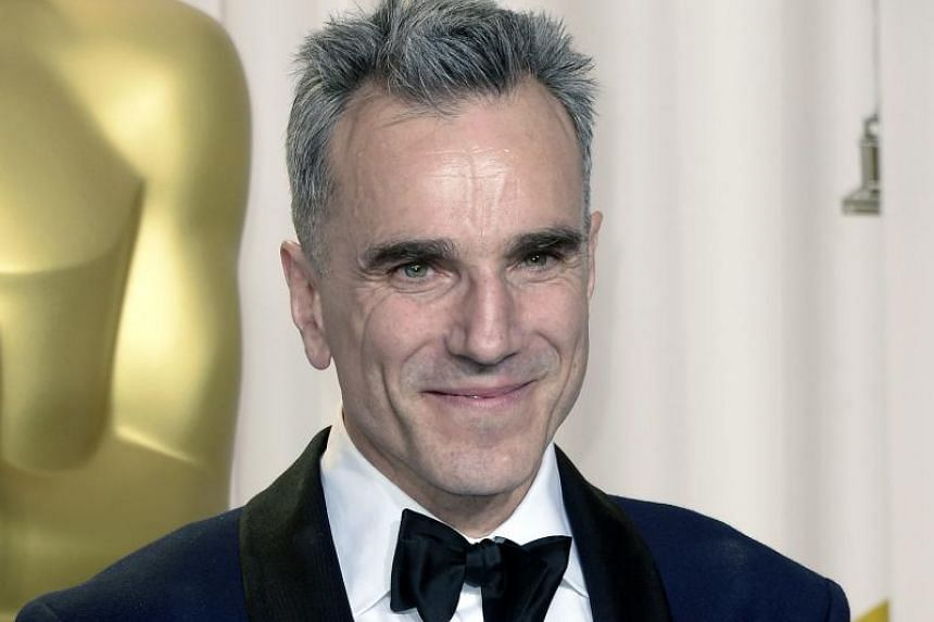 British actor Daniel Day-Lewis holds his Oscar for Performance by an Actor in a Leading Role for Lincoln at the 85th Academy Awards.