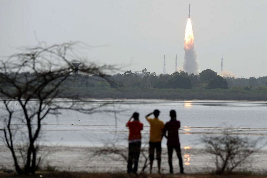An Indian Polar Satellite Launch Vehicle rocket carrying an earth observation satellite along with 30 other nano satellites is launched from the Sathish Dawan Space Station in Andhra Pradesh state on June 23, 2017.