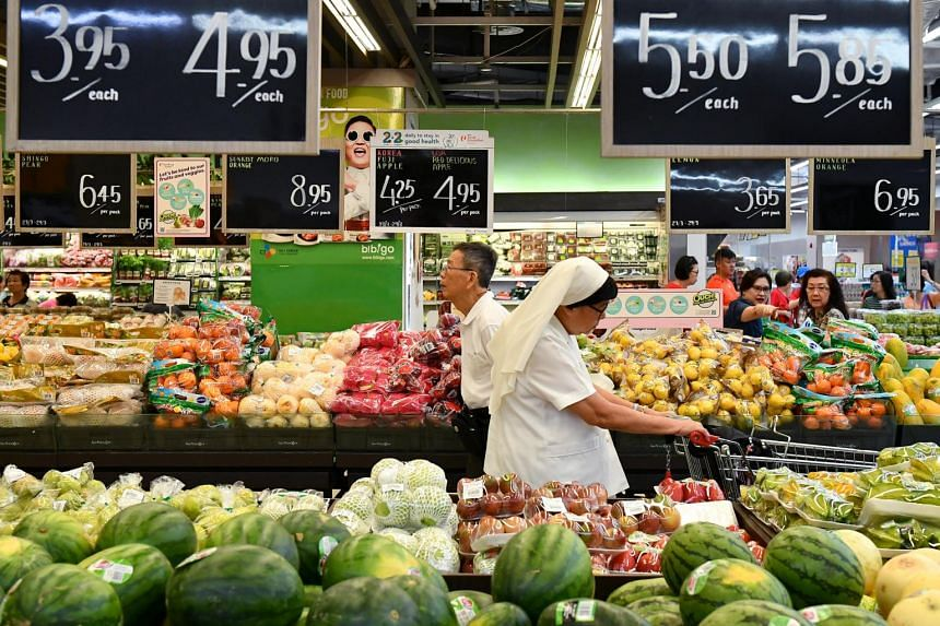 Customers at the fruits section at a FairPrice Xtra supermarket.