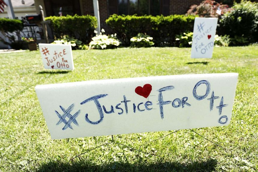 """Signs on the front lawn of Lauren Wadds Wyoming, Ohio home proclaims, """"#Justice For Otto"""" as the the town of Wyoming prepared for the funeral of Otto Warmbier on June 21, 2017."""