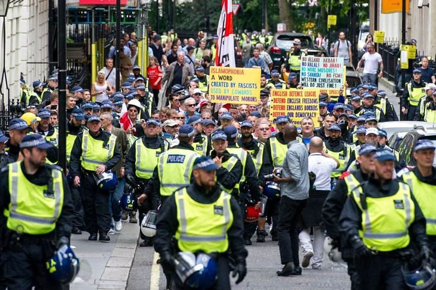 Members of the far-right anti-immigration English Defence League march in London.