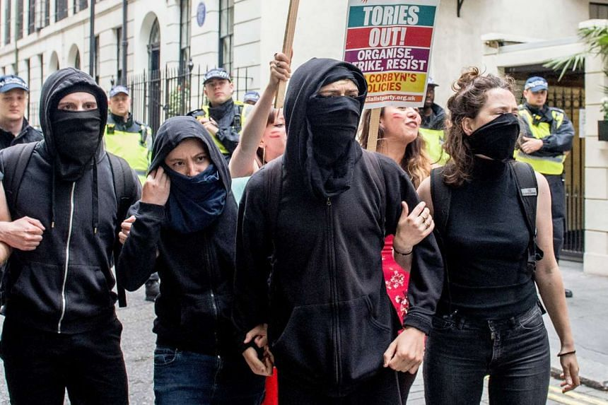 Anti-fascists clash with the police as they attempt to disrupt the English Defence League march in London.