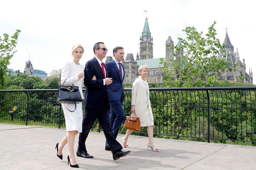 Linton and Mnuchin (left) in Canada in June 2017, with Canadian finance minister Bill Morneau and wife Nancy McCain.