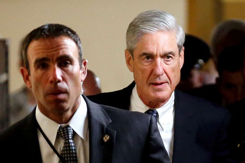 Special Counsel Robert Mueller (right) departs after briefing members of the US Senate on his investigation, June 21, 2017.
