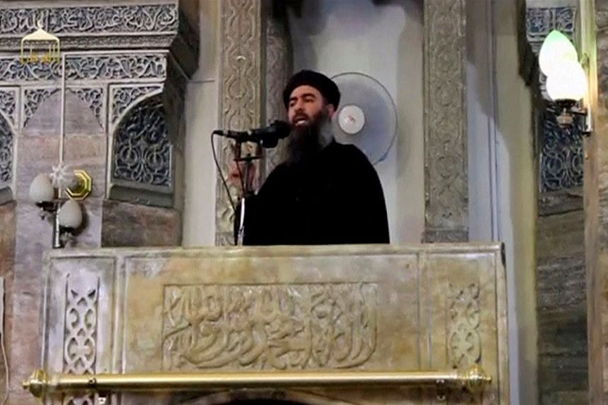 A man purported to be the reclusive leader of ISIS, Abu Bakr al-Baghdadi, in a still image from video.