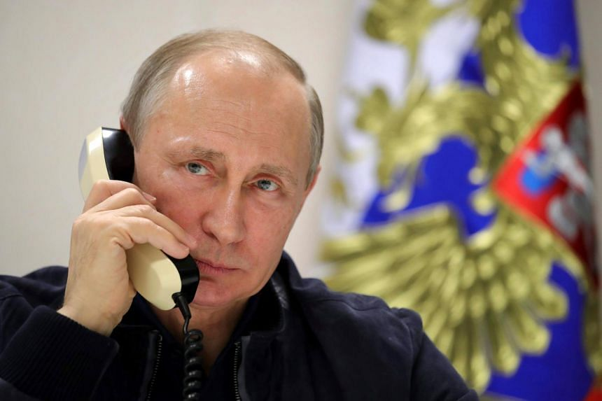 Vladimir Putin speaking over the phone with Turkish President Tayyip Erdogan while he inspects the work on the Turkish Stream gas pipeline project aboard the Pioneering Spirit pipeline-laying ship in the Black Sea near Anapa, Russia on June 23, 2017.