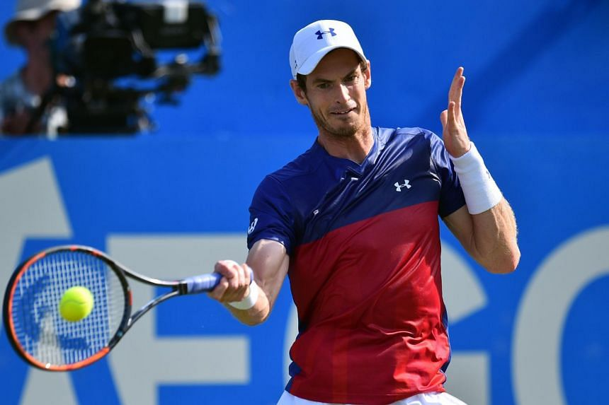Andy Murray returning against Jordan Thompson during their men's singles first round tennis match at the ATP Aegon Championships tennis tournament at Queen's Club in west London on June 20, 2017.