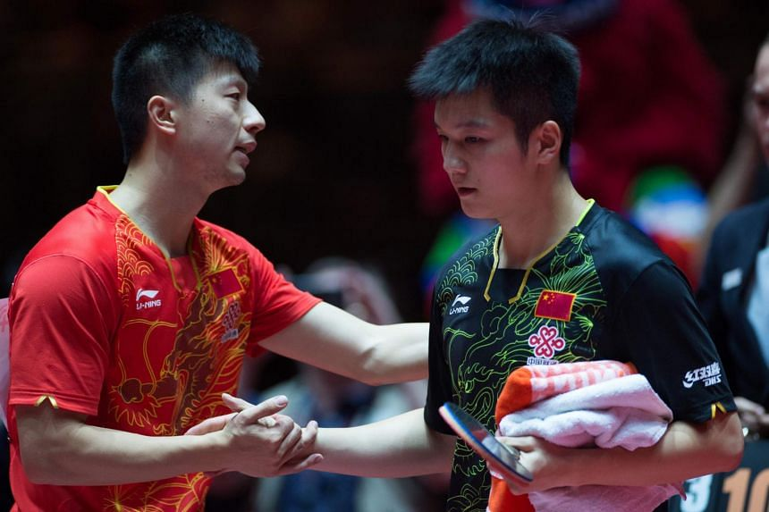 Chinese duo Fan Zhendong (right) and Ma Long are two of the three players who failed to turn up for their singles matches at the China Open on June 23, 2017.