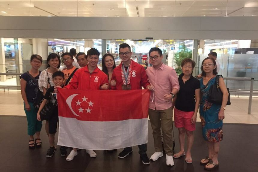 Powerlifting brothers Matthew and Marcus Yap finally touchdown in Singapore after being stranded in Belarus for 30 hours.