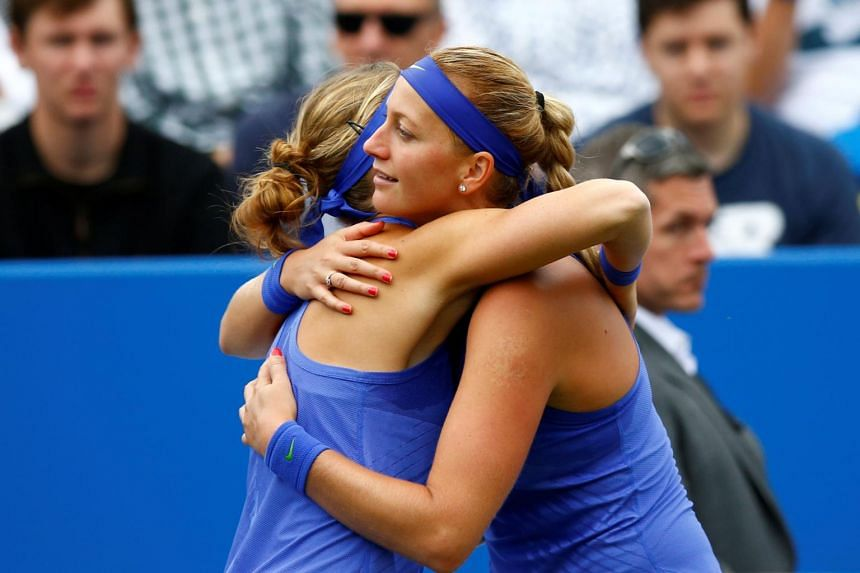 Czech Republic's Petra Kvitova embracing countrywoman Lucie Safarova (left) after the latter withdrew from the semi final due to injury.