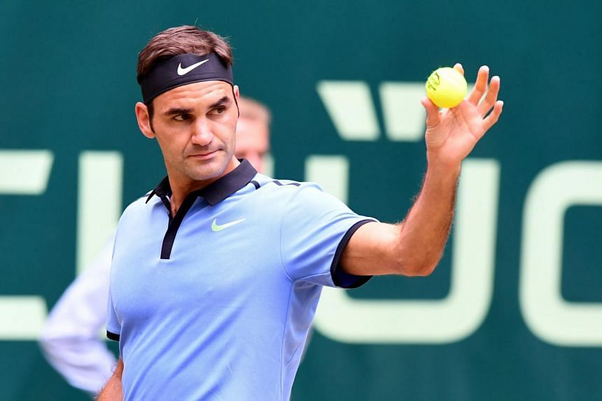 Roger Federer from Switzerland gesturing during his match against Karen Khachanov from Russia at the Gerry Weber Open tennis tournament in Halle, western Germany on June 24, 2017.