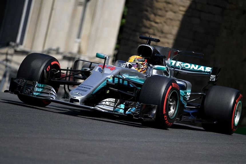 Mercedes' British driver Lewis Hamilton steering his car during the third practice session of the Formula One Azerbaijan Grand Prix at the Baku City Circuit in Baku on June 24, 2017.