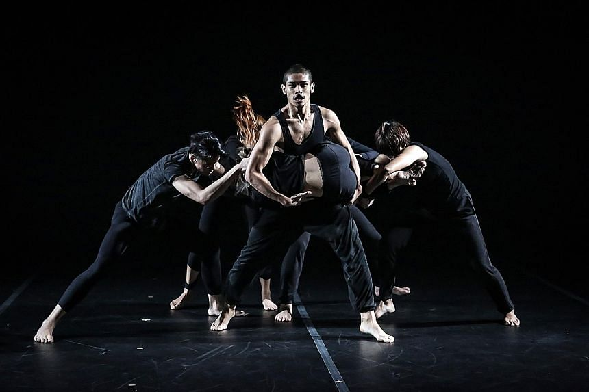 The sparse lighting by designer Adrian Tan enhanced the otherworldly mood and highlighted the sinewy muscles of the dancers in Borderline - By T.H.E Dance Company & Muscle Mouth.