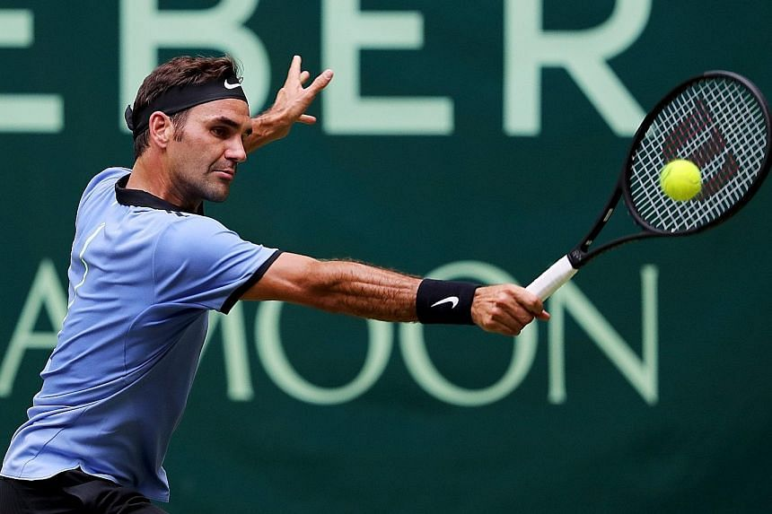 Switzerland's Roger Federer hitting the ball in his second-round match against Mischa Zverev of Germany at the Halle Open on Thursday. The Swiss won 7-6 (7-4), 6-4 to advance to the quarter-finals.
