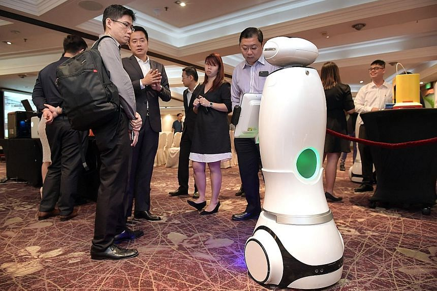 A retail robot interacting with guests at an event last month. According to a study by the McKinsey Global Institute released this year, the easiest jobs to automate are those involving predictable physical activities such as assembly line work in ma