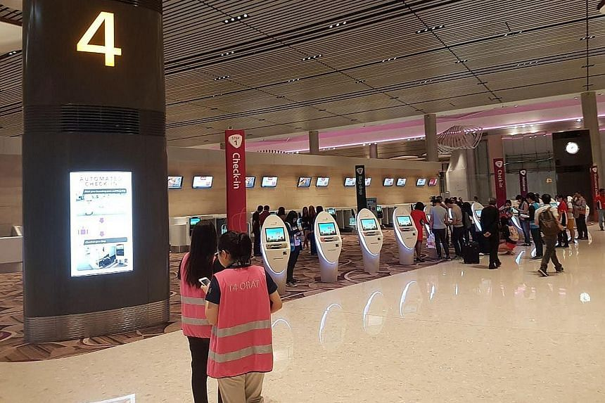 The new Terminal 4 offers a start-to-end automated system to reduce reliance on manpower, though it also features manual counters. Last night, airport staff were on hand to assist passengers who were not familiar with the system.