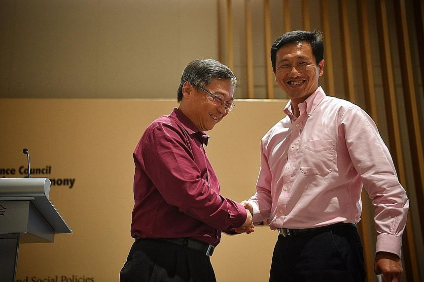 Health Minister Gan Kim Yong (far left), who handed over the chairmanship of CDAC to Education Minister (Higher Education and Skills) Ong Ye Kung yesterday, expressed confidence in Mr Ong's ability to take the group forward.