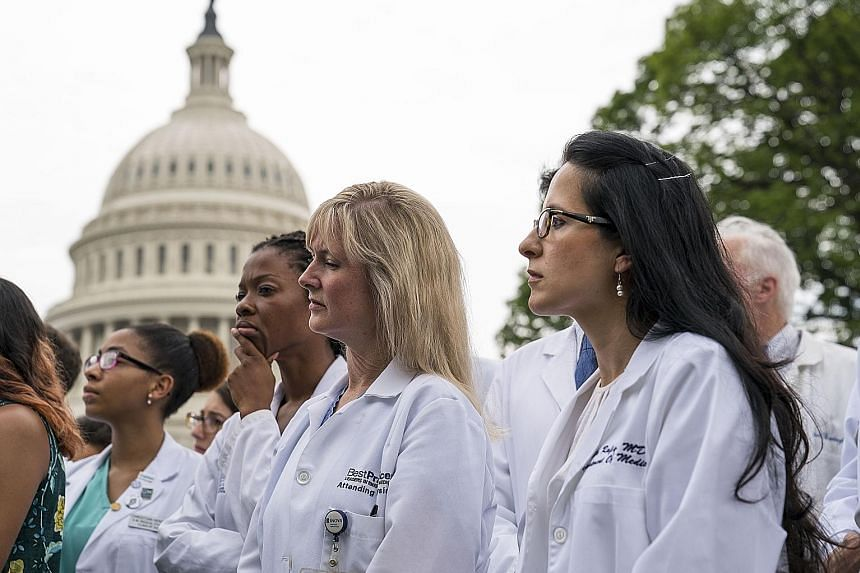"Healthcare workers protesting outside the Capitol on Thursday. Democrats have called the new health plan a ""war on Medicaid""."