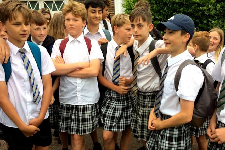 Dozens of schoolboys at the Isca Academy in Britain have gone to class wearing girls' uniform skirts when the head teacher would not relax the dress code banning the more suitable option: shorts.