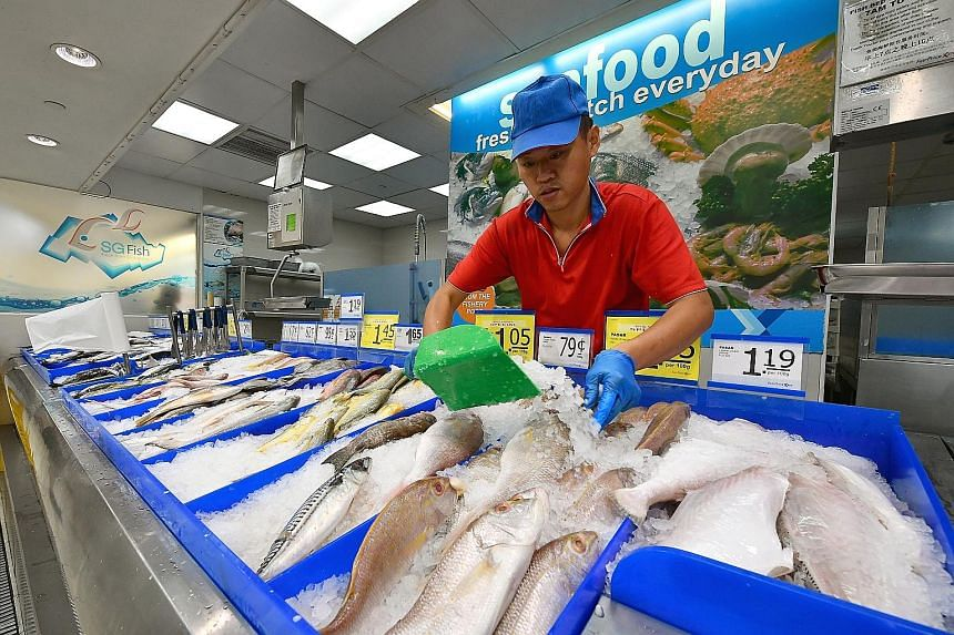 The seafood section at the FairPrice supermarket in Nex mall. Overall food inflation picked up, rising to 1.5 per cent last month from 1.3 per cent in April, driven by a larger increase in the prices of non-cooked food items.