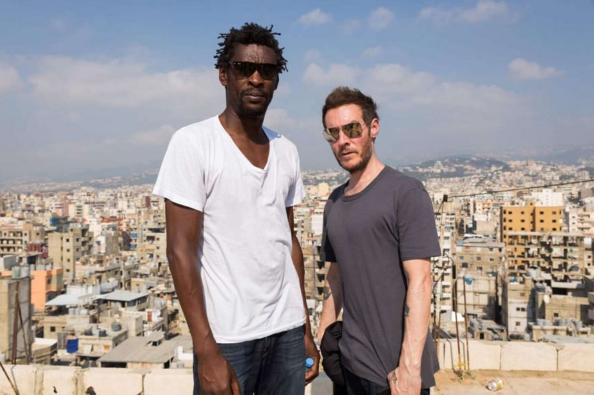 A 2014 photo shows Robert del Naja (right) and Grantley Marshall of British trip-hop band Massive Attack during a visit to Lebanon.