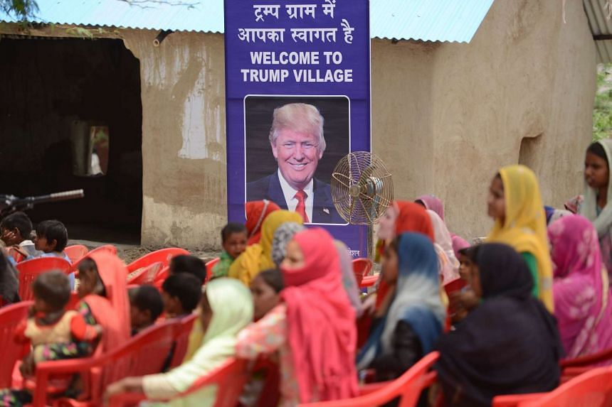 """Women gather to listen to a speaker during a ceremony in the """"Trump Village"""" of Marora, India."""
