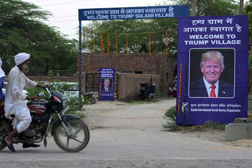 A poster with the image of US President Donald Trump is set up at Marora village.