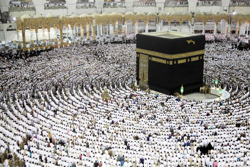 Muslim worshippers pray at the Kaaba, Islam's holiest shrine, at the Grand Mosque in Mecca, June 23, 2017.