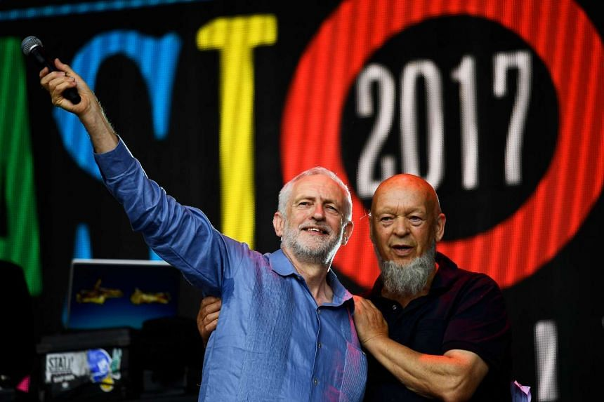 Corbyn and festival organiser Michael Eavis acknowledge the crowd after addressing revellers.