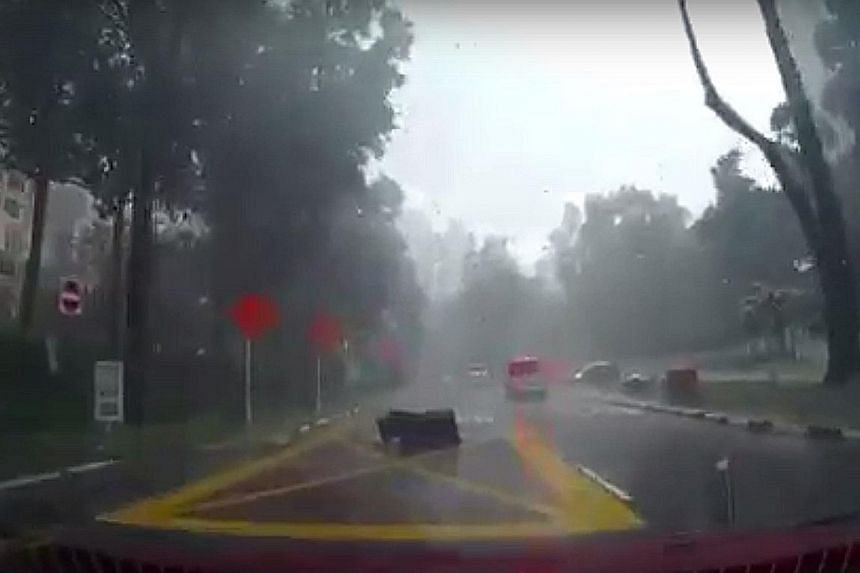 An outdoor sofa landed with a thump and was blown along Grange Road by the strong wind last Friday morning. Mr Peh Choon Whee, who caught the incident on his car dashboard camera, said that upon rewatching the video, he realised there was another cha