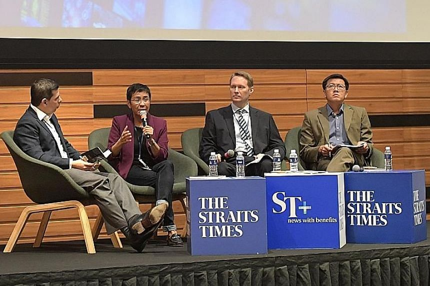 One of the sessions at the two-day forum was Truth and Trust in the Digital Age: The Various Faces of Misinformation, featuring (from left) Straits Times editor Warren Fernandez, who was the moderator, and speakers Maria Ressa, Jason Subler and Eugen