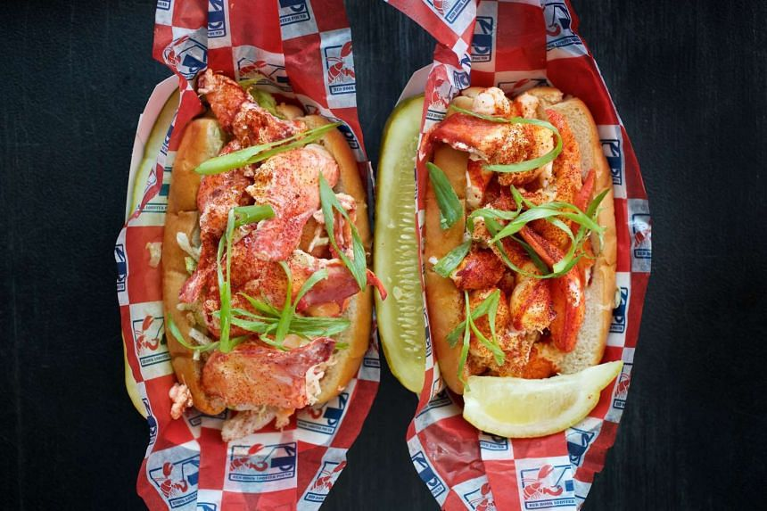 Lobster rolls from the Red Hook Lobster Pound food truck. At left is a Maine-style roll served cold with lemon mayo, and at right is one served Connecticut-style, hot with butter. PHOTO: DEB LINDSEY