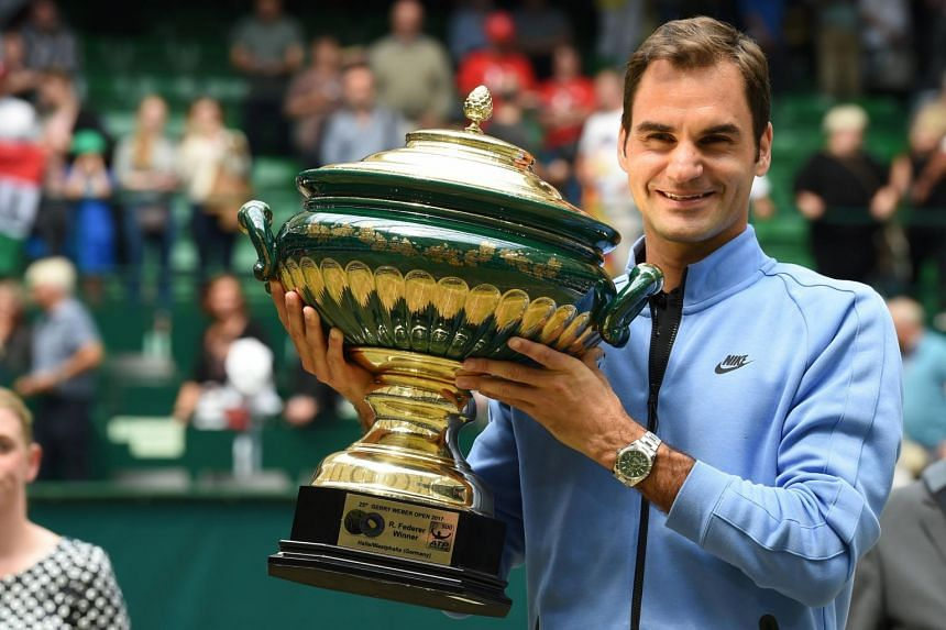 Roger Federer poses with his trophy after winning his final match against Alexander Zverev at the Gerry Weber Open tennis tournament in Halle, western Germany, on June 25, 2017.