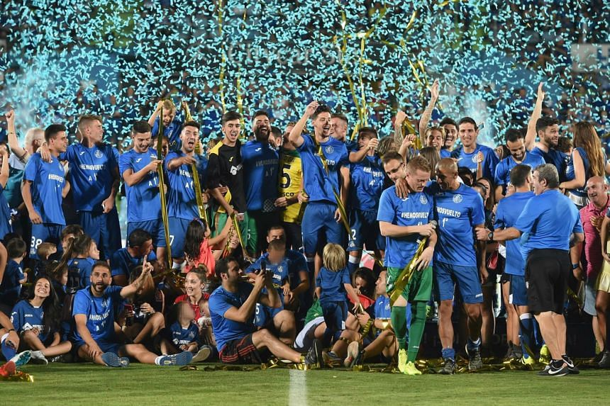 Getafe players celebrating after defeating Tenerife in their final match of the Spanish Second Division at the Coliseum Alfonso Perez in Getafe, Madrid, Spain, on June 24, 2017.