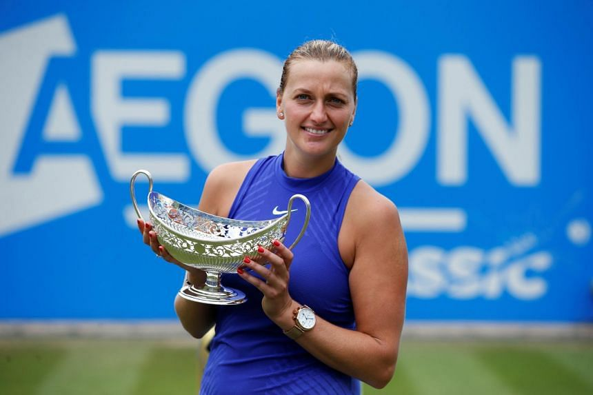 Czech Republic's Petra Kvitova celebrating with the trophy after winning the Birmingham Classic final against Australia's Ashleigh Barty.