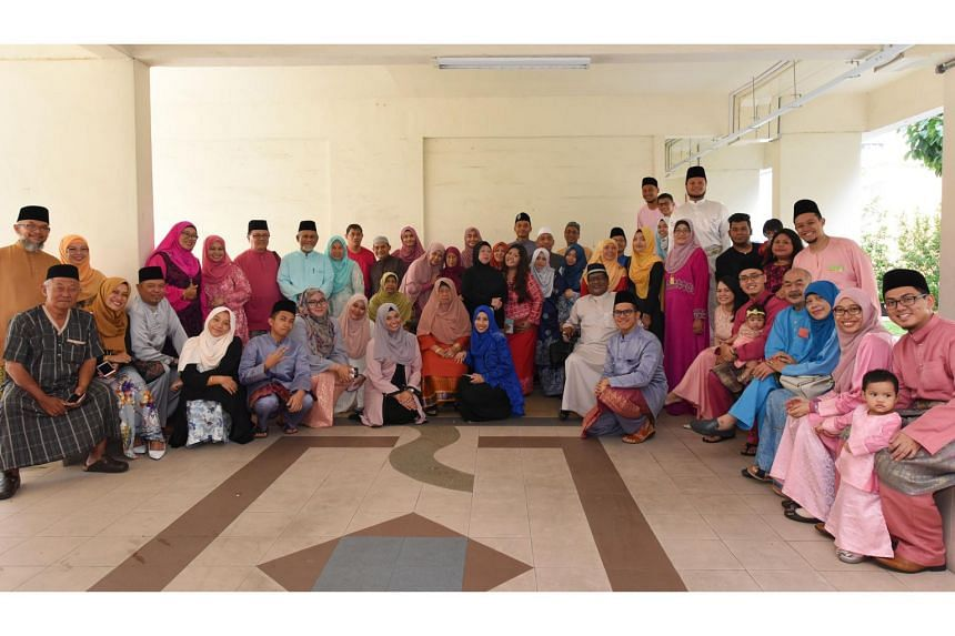 Mr Imis Iskandar (standing, sixth from right, in pink) with his extended family, which spans four generations, during their Hari Raya Aidilfitri celebration on June 25, 2017.