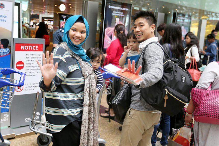 (From left) Ms Rafidah Anip, daughter Husna El Haziq, son Hassan El Haziq and Mr Haziq Halim at the departure hall at Changi Airport on June 25, 2017.