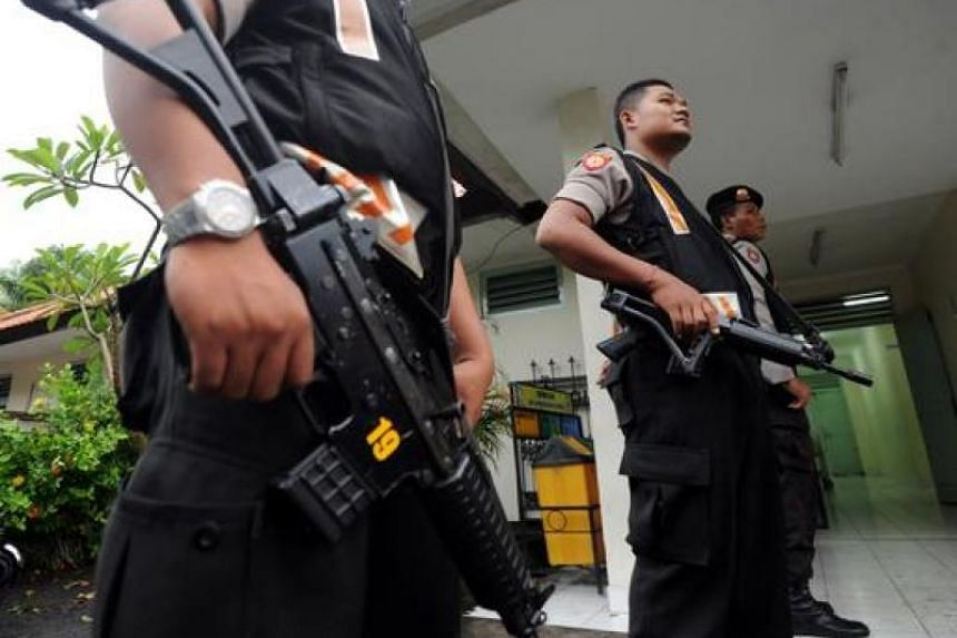 A file photo of Indonesian police personnel standing guard.