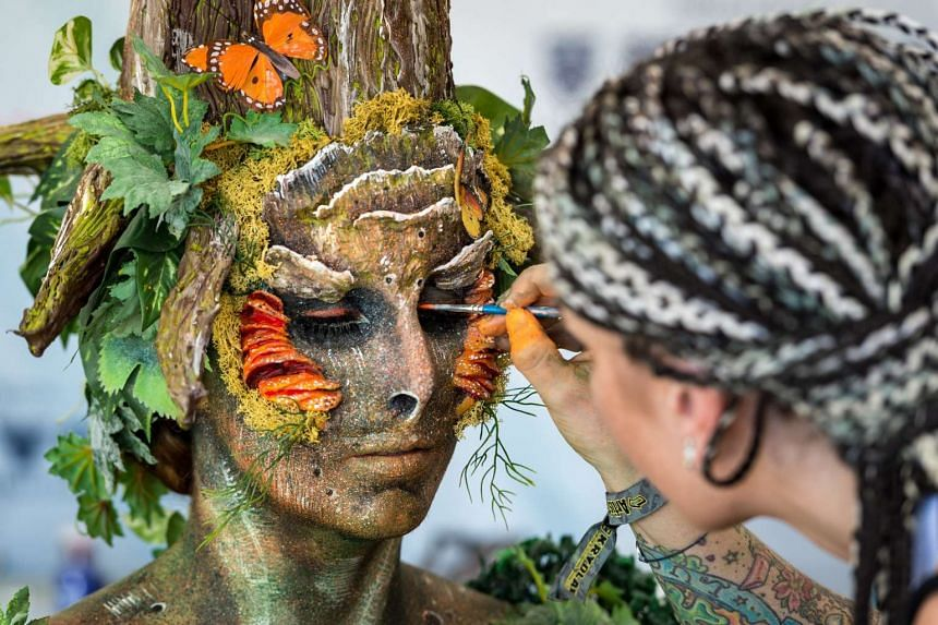 A woman being made up to look like a tree at the World Body Painting festival, which will take place this year at Klagenfurt am Worthersee in Austria.