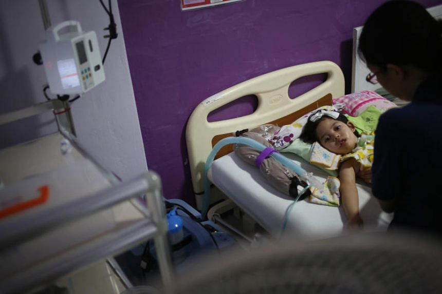 Two-year-old Syifaa Yasyaa Taufan suffers from a congenital neuromuscular disease which makes it difficult for her breathe, swallow, and prone to chest infections. At her tender age, she has spent nine months in hospital. But she has not been admitte