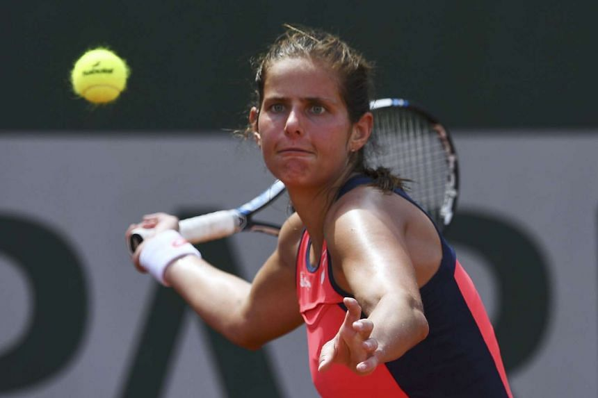 Germany's Julia Goerges returns the ball to Madison Brengle of the US.