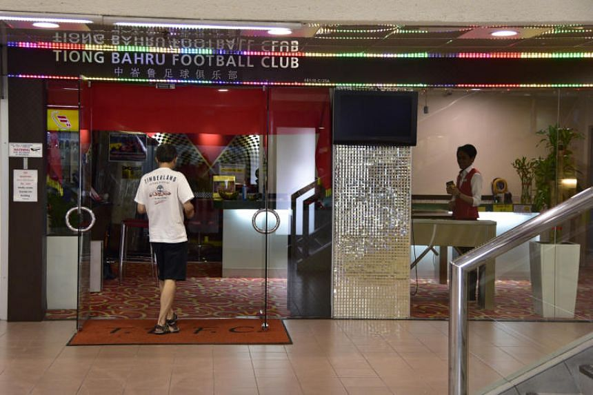 A patron going into Tiong Bahru Football Club's clubhouse at People's Park Centre.