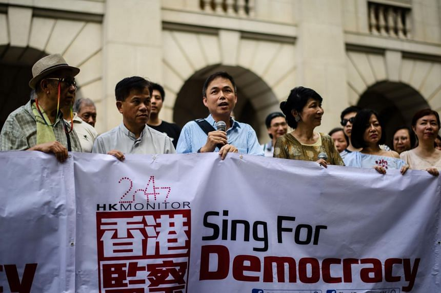 """Edward Chin (centre) and Claudia Mo (fourth from left) taking part in a """"Sing4DemocracyHK"""" protest outside the Court of Final Appeal in Hong Kong on June 26, 2017."""