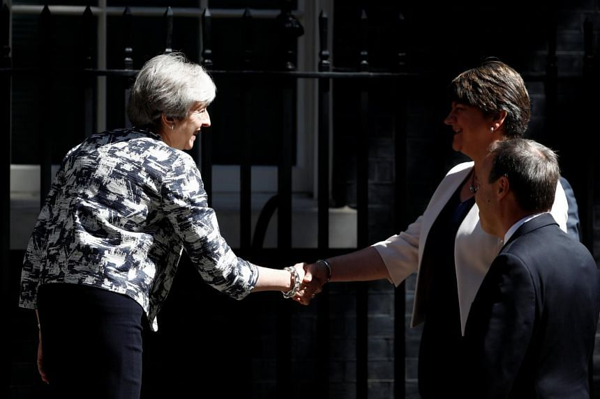 Britain's Prime Minister, Theresa May, shaking hands with Democratic Unionist Party (DUP) Leader Arlene Foster, outside 10 Downing Street, in central London, Britain June 26, 2017.