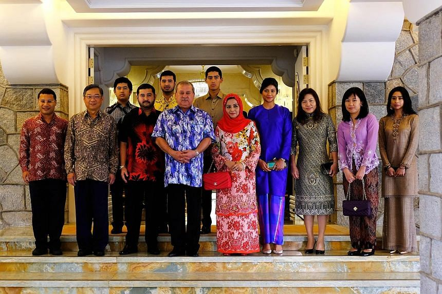 From far left: Ministers Desmond Lee and Gan Kim Yong with Johor Crown Prince Tunku Ismail Sultan Ibrahim, Johor Sultan Ibrahim Sultan Iskandar, Her Royal Highness Raja Zarith Sofiah, other members of the royal family, and Mr Gan and Mr Lee's spouses