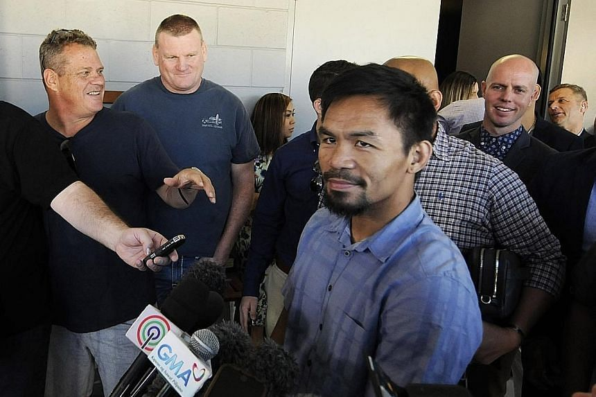 Filipino boxer Manny Pacquiao leaving the Worship Centre Christian Church in Brisbane after attending service yesterday. The WBO welterweight champion will be defending his belt against unbeaten Australian Jeff Horn at the Suncorp Stadium on Sunday.